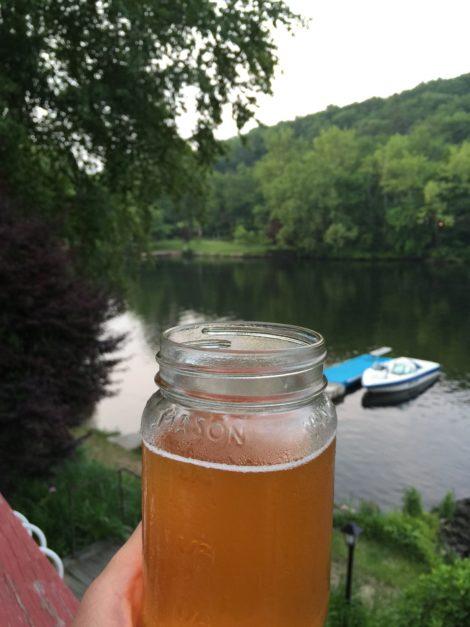 Enjoying a craft beer at the lake